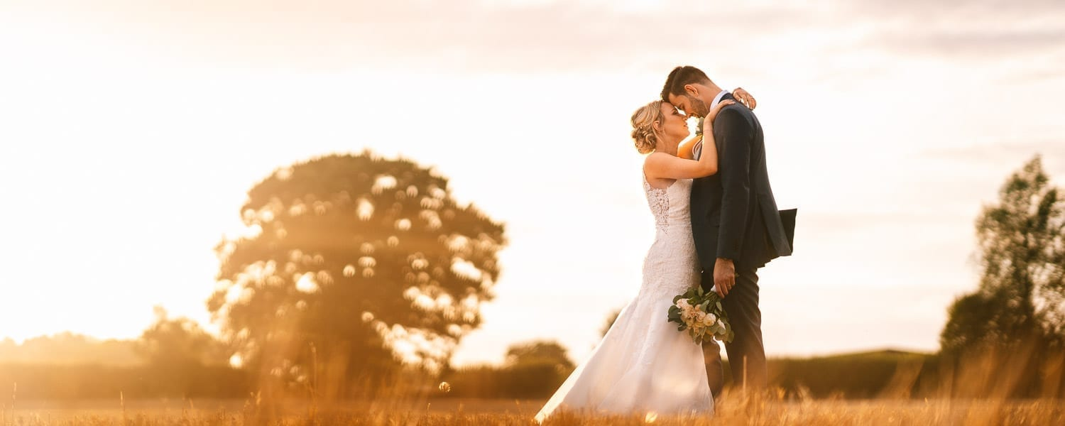 Amazing sunset photo of wedding couple photographed by Sussex wedding photographer Moritz Schmittat